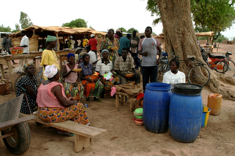 rural-market-in-burkina-women-sell-and-drink-local-brew